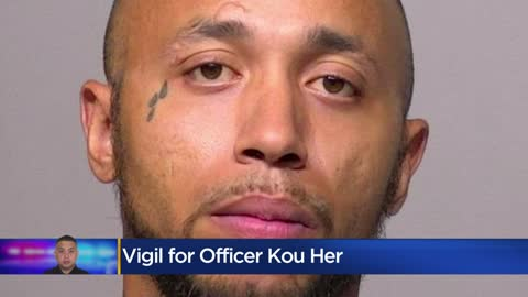 Dozens gather for vigil held for Milwaukee Officer Kou Her